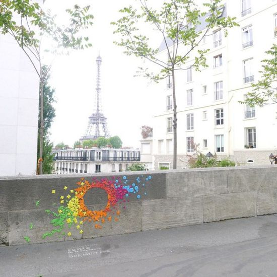 French artist Mademoiselle Maurice creates stunning geometric figures on urban surfaces in Paris. For her recent project Rainbow, she used hundreds of colorful folded origami figures. Each of simple geometric shapes represents ideas such as harmony, spirituality and balance. Rainbow is a temporary installation.