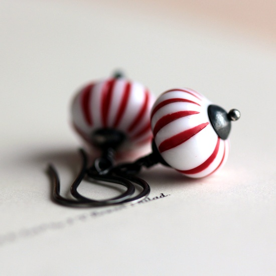 Earrings striped like peppermint candy are   festive and fun. $32.00