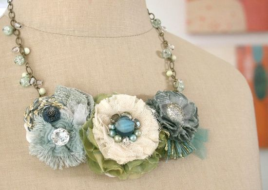 vintage jewelry pieces on top of handmade flowers