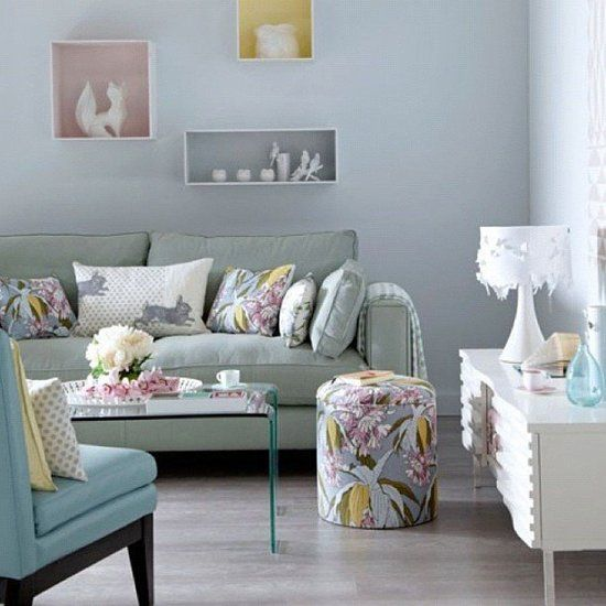 Great pops of color in this room with the wall decor and decorative pillows.