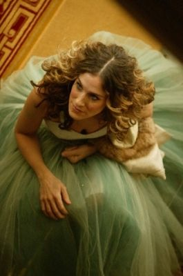 "Carrie Bradshaw... green tulle dress. last episode of Sex and the City when her necklace fell and she saw ""big"" John walking inside the hotel."