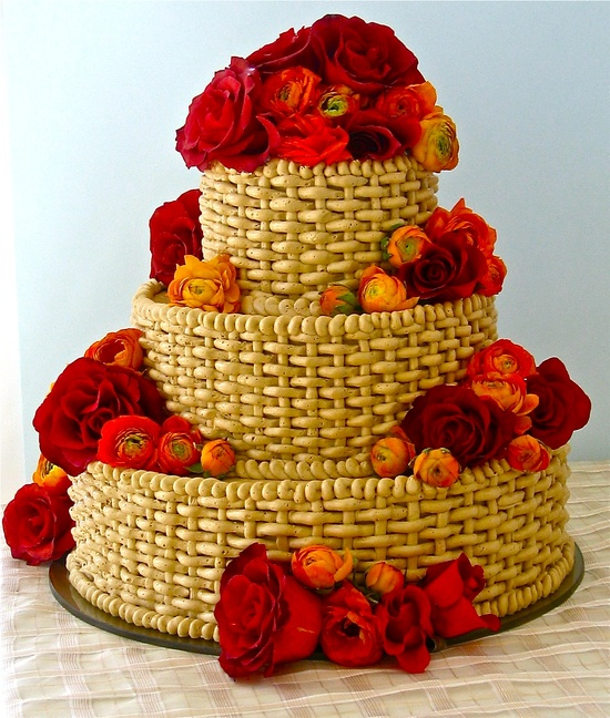 This is my Brown Sugar, Pecan and Peaches Cake from Wedding Cakes You Can Make. A brown sugar pecan cake brushed with peach liqueur syrup, filled and frosted with caramel buttercream piped in a basketweave pattern using a round tip. Any fresh flowers you like could enhance the tiers. www.amazon.com/...