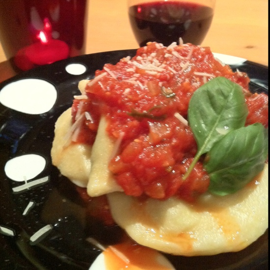 Handmade Ravioli stuffed with spinach, prosciutto, parmesan, and ricotta topped with a garlic basil marinara from scratch