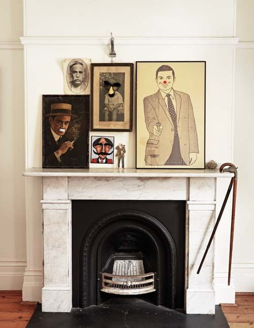 portraits over fireplace