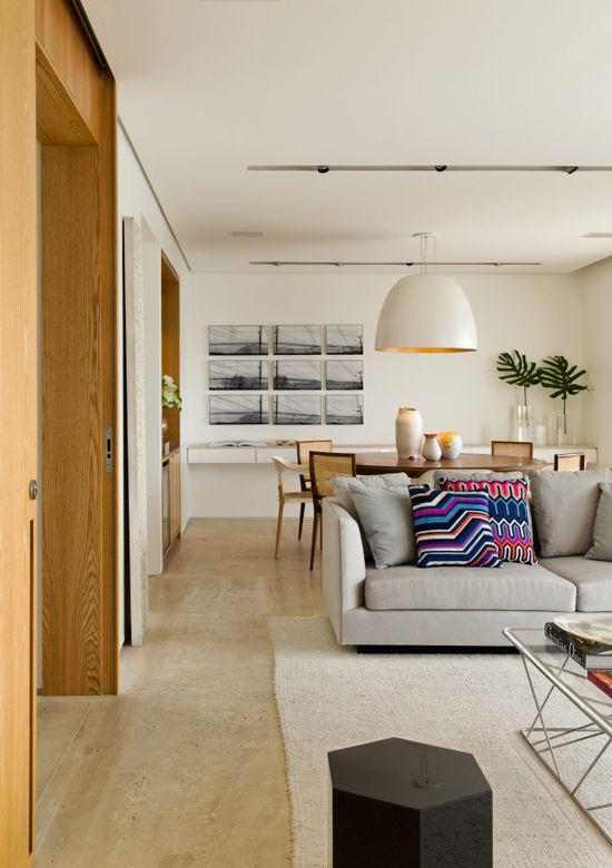 This is a big space, however, the look can be recreated for a small apartment.  You achieve an open bigger look with the placement of furniture and using wall space to showcase your treasures and provide storage. Small does not have to be closed in and uncomfortable.  Use your imagination and save floor space wherever possible.