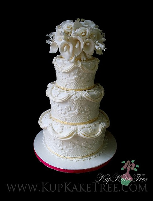 Cala lilies and fondant lace & swags wedding cake