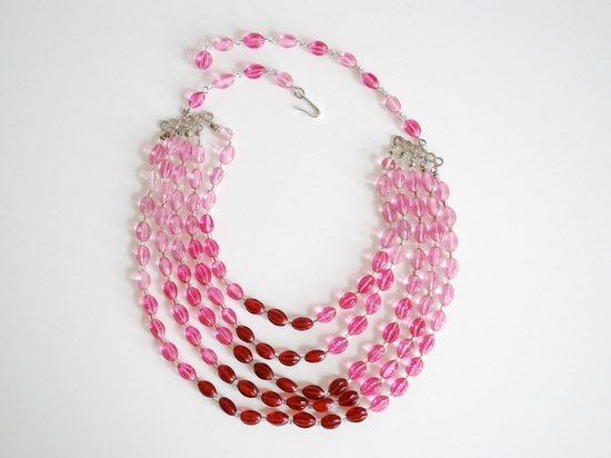 A beautiful, girly multi-strand 1950s necklace full of pink and red glass beads. #vintage #jewelry #accessories #pink #1950s #necklace