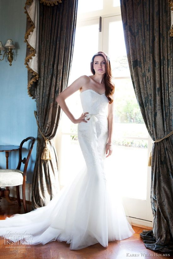 Allegra strapless mermaid wedding gown with corded lace bodice & tulle circle skirt, finished with a grosgrain ribbon belt and sheer tulle at the neckline.   ????