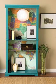 world map lining the back of a bright bookshelf