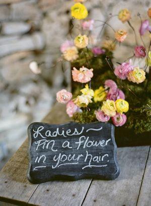 Ladies - pin a flower in your hair. Cute idea!