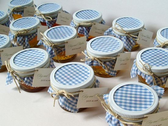 Mason jars filled with something sweet and then a patch of fabric as a favor.