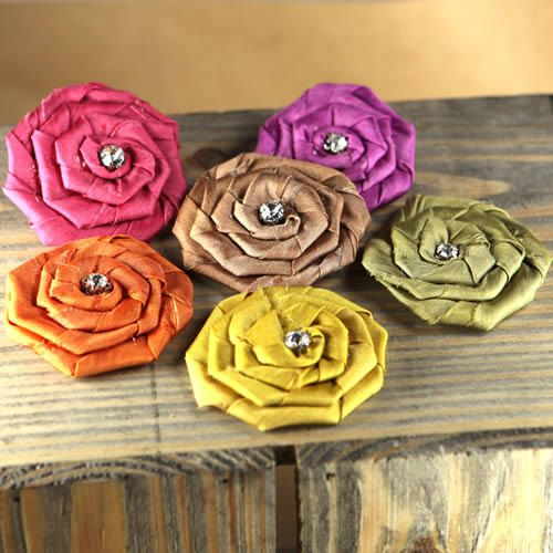 Jewel Mix Satin Coiled Flowers with Crystal Center. via Etsy
