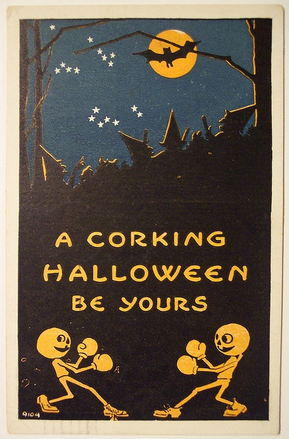 another vintage halloween postcard. i love the boxing pumpkins! ha!