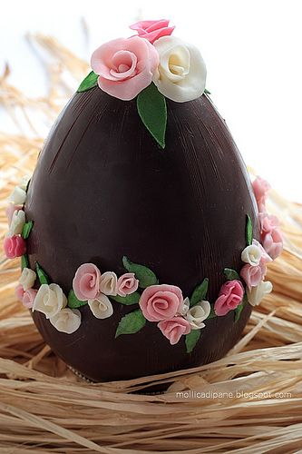 chocolate egg with pink, white flowers