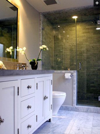 Love the white vanity with the clean lines and dark shower