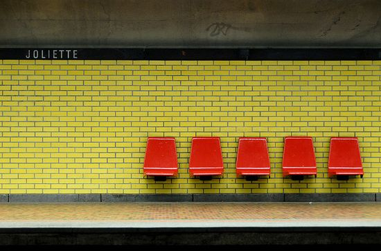 red chairs; chartreuse wall