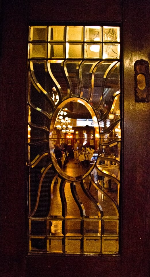 Leaded glass door at Antoine's Restaurant in New Orleans Louisiana. Photo by Roy Guste.