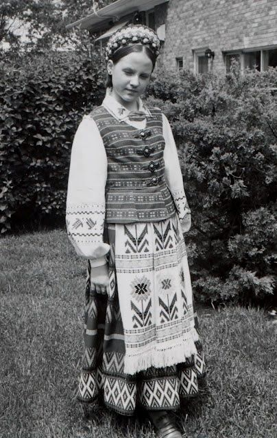When I reached the seventh grade, I transitioned from the short, girl's Lithuanian folkdress and grew into a pre-teen model. The pre-teen folkdresses were mass produced, and many girls had similar ones, but in different colors. My new folkdress was green and gold; another common color was
