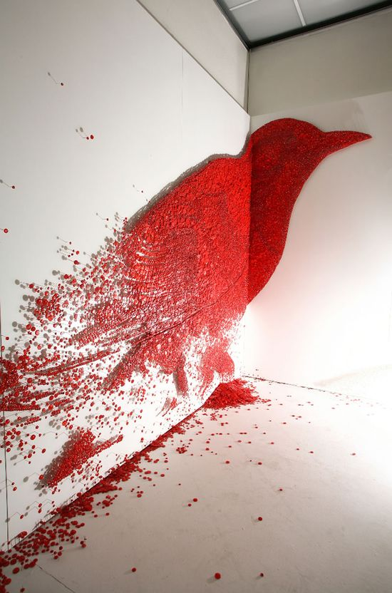 Dreaming of Joy by  Ran Hwang: Made of thousands of red buttons each secured by a pin to a wooden panel,  the artist's painstaking execution is akin to a monk practicing Zen. The piece was only complete when the bird was surrounded by a 'cage'. Installation #Bird #Pins #Ran_Hwang #Dreaming_of_Joy