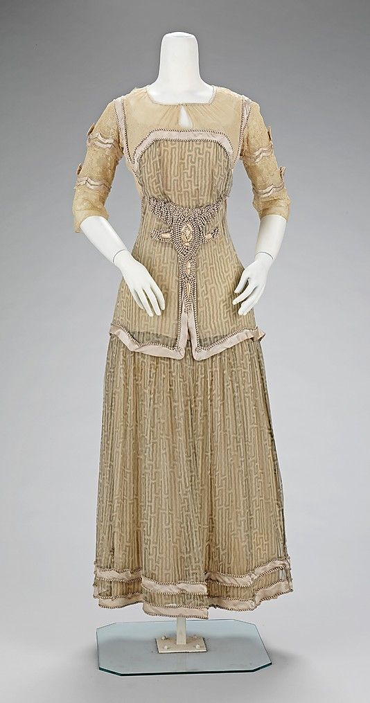 Afternoon dress House of Paquin (French, 1891–1956) Designer: Mme. Jeanne Paquin (French, 1869–1936) Date: 1909 Culture: French Medium: silk Dimensions: Length at CB: 50 in. (127 cm) Credit Line: Brooklyn Museum Costume Collection at The Metropolitan Museum of Art, Gift of the Brooklyn Museum, 2009; Gift of Julian Asion, 1988 Accession Number: 2009.300.1618