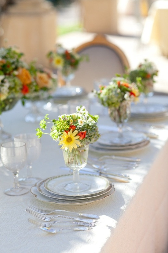 cute wild arrangements in parfait glasses--love the idea of individual arrangements and no centerpiece. Guests take as a gift.