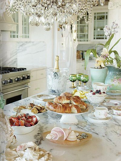 white marble and chandeliers in the kitchen