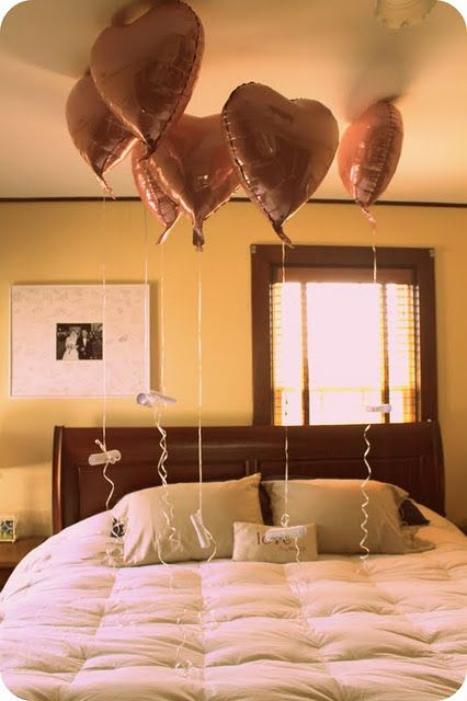 buy a balloon for each year you have been married, tie to the string a story/memory that is special to the two of you.