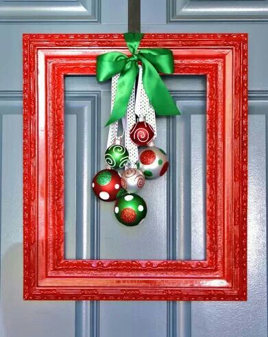 Frame painted red, with ornaments. Super cute. Could use whatever colors I wanted.  Wouldn't use on front door but would look great on the wall near the tree. Or above the fireplace.