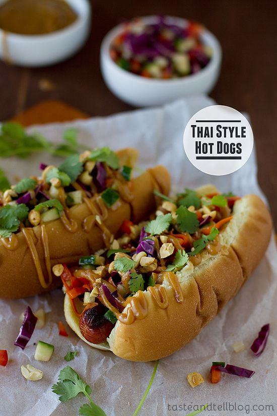 Thai Style Hot Dogs - Hot dogs are topped with Thai-inspired slaw, peanut sauce, chopped peanuts and cilantro.  #fusion #recipe #food #snackfood