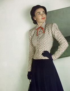 Model is wearing a rayon-figured challis jacket with a wool and rayon skirt in navy, both by Bedford Casual, 1947. #vintage #fashion #1940s
