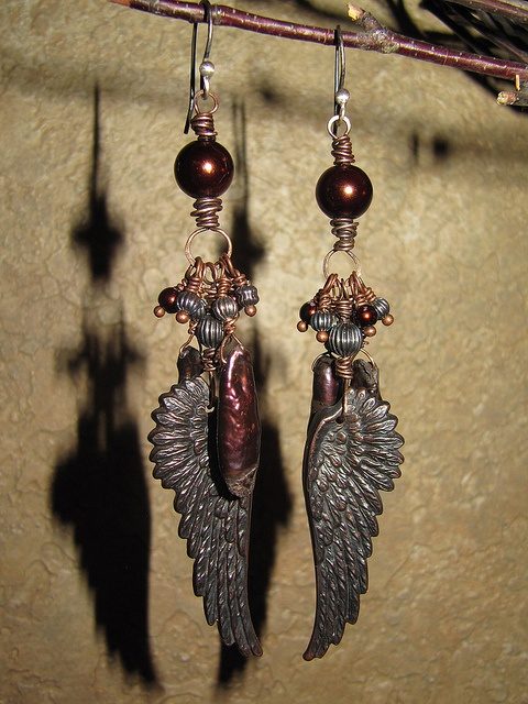 Fab wire wrapping and design from Heidi Horan, who used our rusty black wings, which she distressed to reveal their copper core.