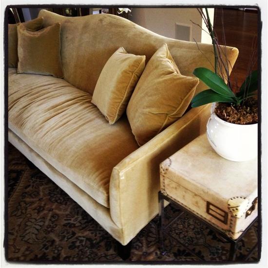 camel mohair sofa, vellum trunk, antique Majal rug