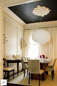 Crown molding on ceiling, chandelier, and black to break up the rooms