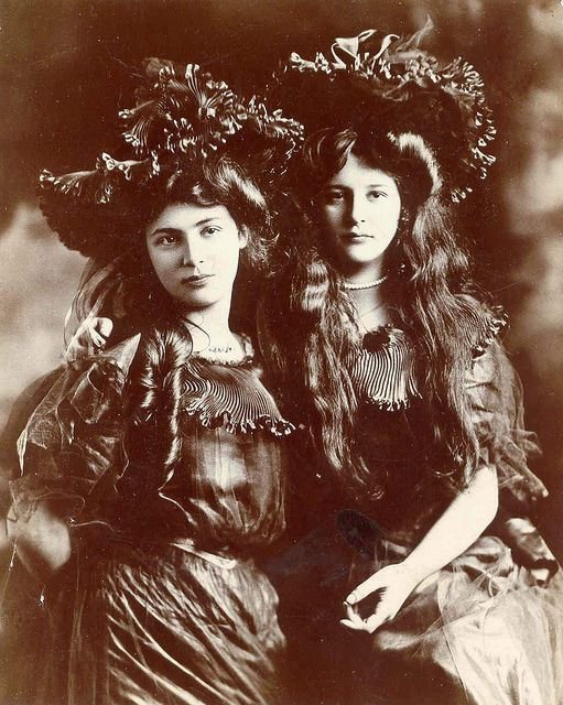 Two muse-worthy beauties pose in identical ensembles for the camera in this captivating Edwardian image. #vintage #Edwardian #1900s #woman #long_hair #portrait #antique