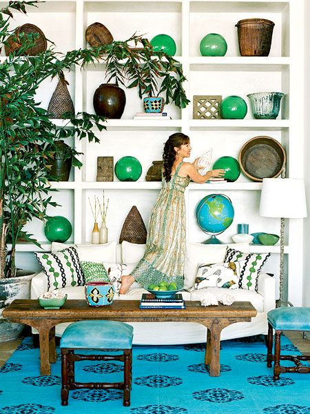 Three cool shades—emerald green, rich turquoise, and deep marine blue—create the base for this Malibu Beach, California, living room. A woven cotton rug, two leather ottomans, and vibrant accessories create a casual, coastal living space. (Photo: Lisa Romerein)