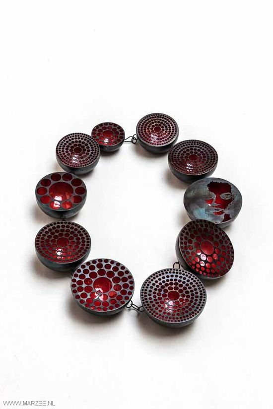 Vera siemund, necklace, 2011, enamelled steeldrilled, sawn, embossed, enamelled, mounted - 220 x 260 x 35 mm - steel hemispheres, red enamelled inside, drilled pattern   sawn portrait