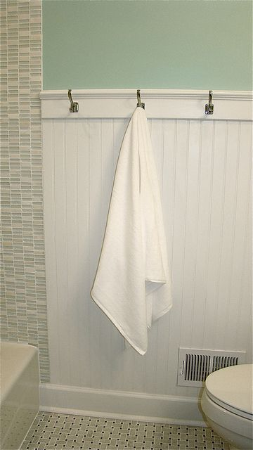 Love the beadboard in the bathroom with the towel hooks and add a small ledge to the top of the beadboard for decor