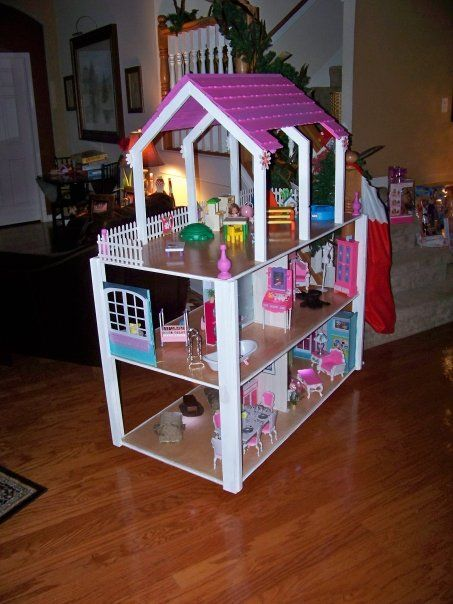 Barbie house complete with crown molding and handmade furniture
