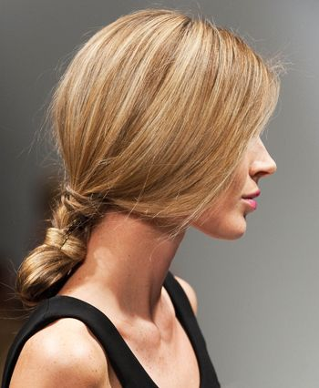 To get this simple, feminine style, just make a low ponytail, then twist it back onto itself and pin into place.