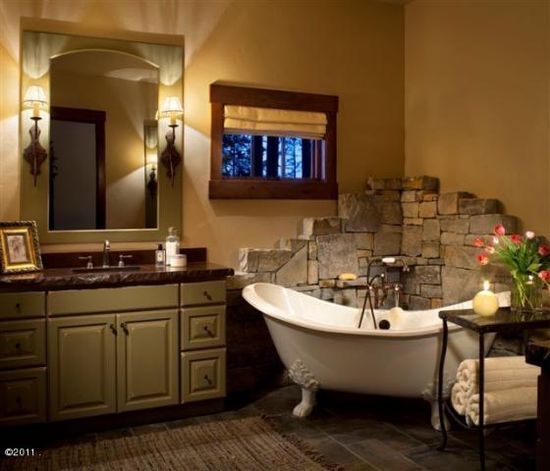 Love the stone behind the tub!