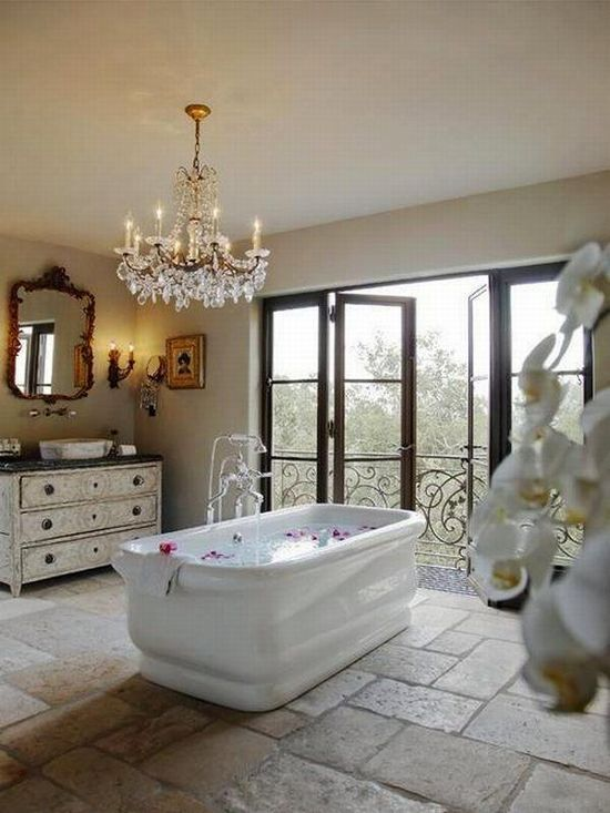 I'm so having this bathroom one day.  It's clean, and pure.  Plus, you could watch the sunset while drinking a glass of wine, reading a good book, and soaking in a hot bath.