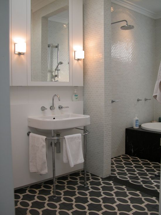 white bathroom with decorative tiled floor
