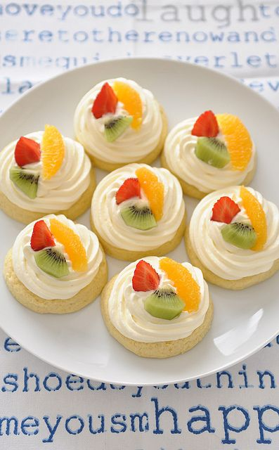 Mini fruit tarts on cookies.
