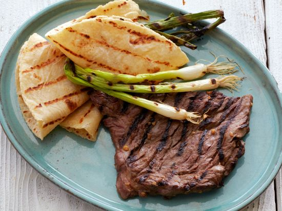 Korean-Style Marinated Skirt Steak with Grilled Scallions and Warm Tortillas from FoodNetwork.com