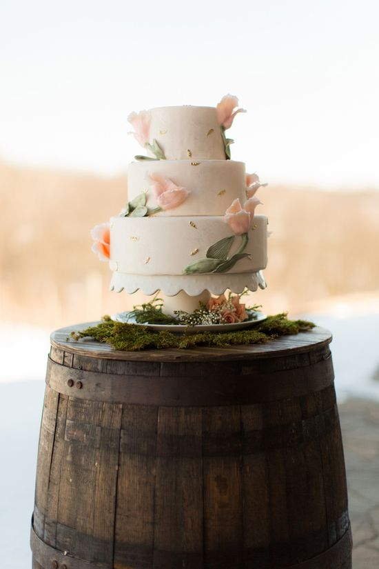 wedding cake with light pink florals with flecks of gold // photo by Emily Crall Photography