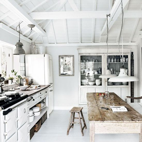 chalky white kitchen + rustic table & lighting