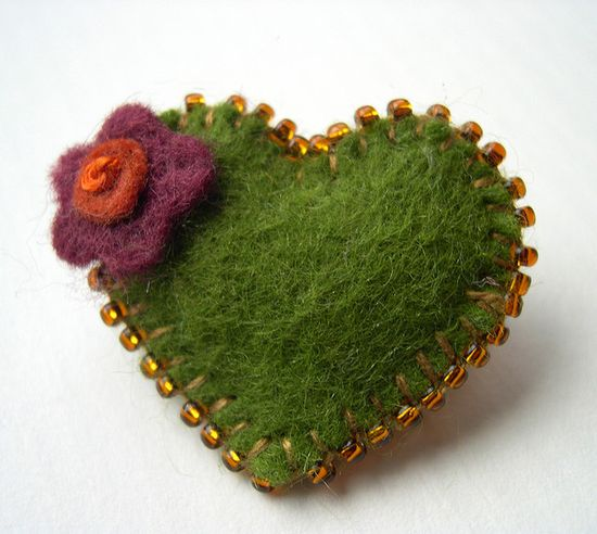 Beads on blanket stitch, i love the simplicity.