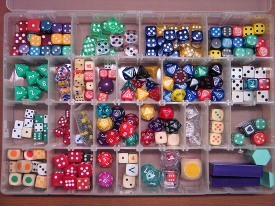 Dice collection stored in plastic container