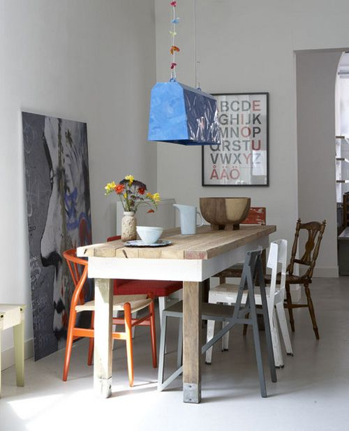 rustic table and mismatched multicoloured chairs