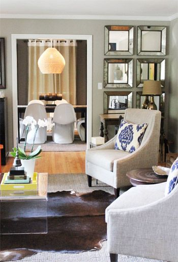 like the neutral chairs with a pop of color in the pillow